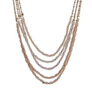 "Gold tone multi layer necklace with ivory and peach beads. Approximately 32"" in length."