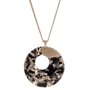 "Gold tone necklace displaying a black and ivory tortoise circle pendant. Approximately 32"" in length."