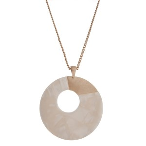 "Gold tone necklace displaying an ivory tortoise circle pendant. Approximately 32"" in length."