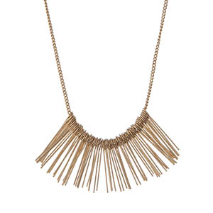 "Dainty gold tone necklace displaying metal fringe. Approximately 24"" in length."