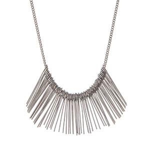 "Dainty silver tone necklace displaying metal fringe. Approximately 24"" in length."