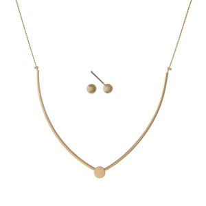 "Dainty gold tone necklace set with a clear rhinestone. Approximately 16"" in length."