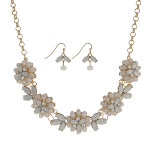 "Gold tone necklace set featuring five white opal glass stone flowers accented by clear rhinestones. Approximately 18"" in length."