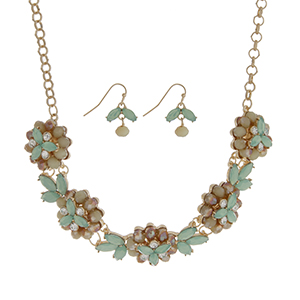 "Gold tone necklace set featuring five mint green glass stone flowers accented by clear rhinestones. Approximately 18"" in length."