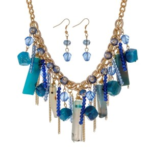 "Gold tone necklace set with clusters of blue natural stones, beads and chain tassels. Approximately 16"" in length."