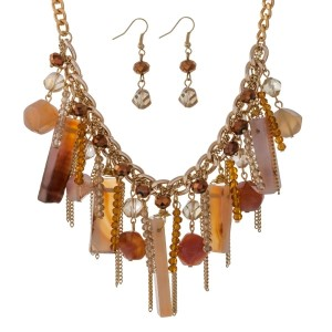 "Gold tone necklace set with clusters of topaz natural stones, beads and chain tassels. Approximately 16"" in length."