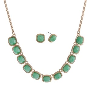 "Gold tone necklace set with faceted mint green square stones and matching stud earrings. Approximately 16"" in length."