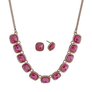 "Gold tone necklace set with faceted hot pink square stones and matching stud earrings. Approximately 16"" in length."