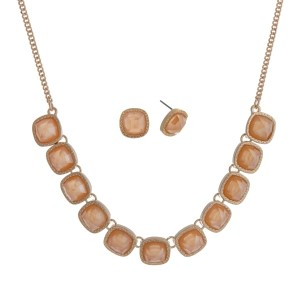 "Gold tone necklace set with faceted peach square stones and matching stud earrings. Approximately 16"" in length."