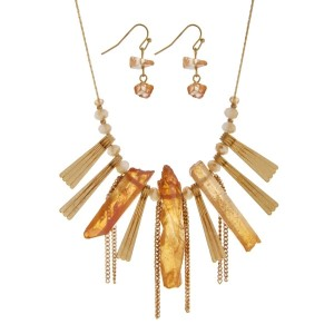 "Gold tone necklace set with champagne glass beads, metal fringe, and peach natural stones. Approximately 16"" in length."
