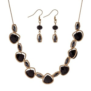"Gold tone necklace set with black faceted teardrop stones and matching fishhook earrings. Approximately 16"" in length."