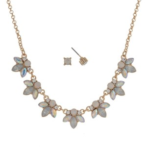 "Gold tone necklace set with white opal flowers and clear rhinestone accents. Approximately 16"" in length."