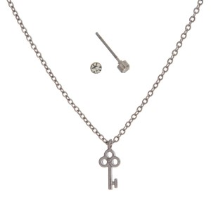 "Dainty silver tone necklace set with a key charm and stud earrings. Approximately 16"" in length."