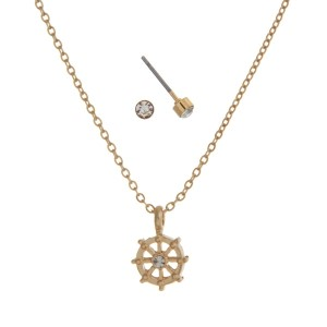"Dainty gold dipped necklace set with a captain's wheel charm and stud earrings. Approximately 16"" in length."
