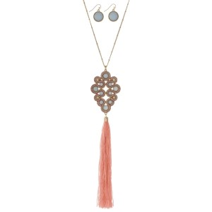 "Gold tone necklace set with a light pink and yellow beaded pendant and a 5"" fabric tassel. Approximately 34"" in length."