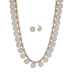 "Gold tone necklace set with round ivory cabochons and white opal rhinestones. Approximately 16"" in length."