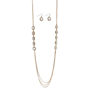 "Gold tone necklace set with silver stationary circles and matching earrings. Approximately 32"" in length."