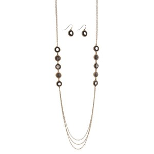 """Gold tone necklace set with hematite stationary circles and matching earrings. Approximately 32"""" in length."""