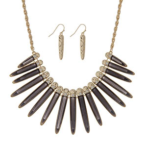 "Gold tone necklace set displaying shimmering black epoxy fringe with white opal stones. Approximately 18"" in length."