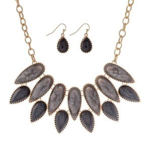 """Gold tone necklace set with black and gray teardrop stones and matching fishhook earrings. Approximately 16"""" in length."""