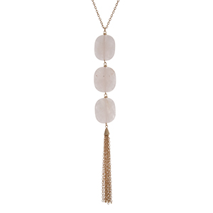 "Gold tone necklace with three rose quartz square natural stones and a metal tassel. Approximately 36"" in length."