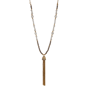"Gold tone necklace white pearl beads, gray glass beads and a chain tassel. Approximately 32"" in length."
