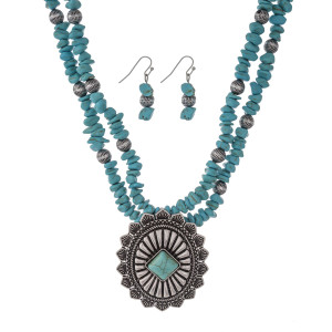 """Silver tone statement necklace set with turquoise chip stones and a concho pendant. Approximately 16"""" in length."""