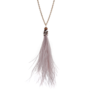 "Gold tone necklace with an ivory feather tassel pendant accented with gray and light brown wooden beads. Approximately 38"" in length."