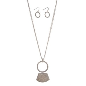 "Silver tone necklace with a geometric brushed pendant. Approximately 32"" in length."