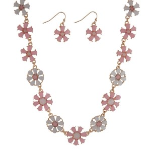 "Gold tone necklace seat featuring white and pale pink flowers with matching earrings. Approximately 16"" in length."