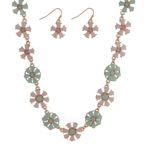 "Gold tone necklace seat featuring mint green and pale pink flowers with matching earrings. Approximately 16"" in length."