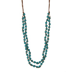 "Brown cord necklace with turquoise faceted beads. Approximately 32"" in length. Handmade in the USA."