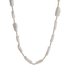 """Freshwater pearl necklace with mint green beads. Approximately 30"""" in length."""