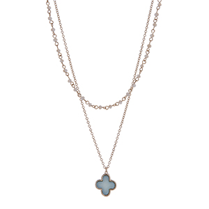 "Gold tone double row necklace with champagne beads and a light blue quatrefoil pendant. Approximately 18"" in length"