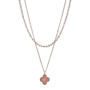 "Gold tone double row necklace with champagne beads and a peach quatrefoil pendant. Approximately 18"" in length"