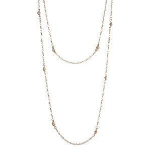 "Gold tone double layer necklace with clear rhinestone stationaries. Approximately 36"" in length."