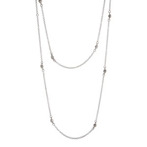 "Silver tone double layer necklace with clear rhinestone stationaries. Approximately 36"" in length."