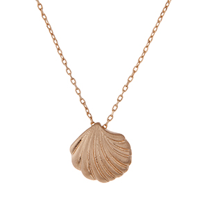 "Dainty gold tone necklace with a seashell charm. Approximately 16"" in length."