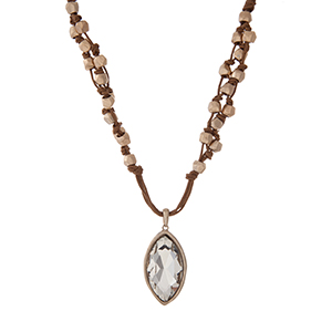 """Brown cord necklace with gold tone beads and a clear rhinestone pendant. Approximately 16"""" in length."""