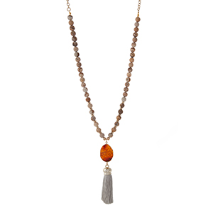 "Gold tone necklace displaying picture jasper natural stone beads and a gray fabric tassel. Approximately 32"" in length."