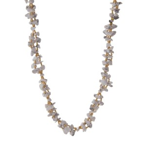 "Gold tone necklace featuring howlite natural chip stones. Approximately 30"" in length. Handmade in the USA."