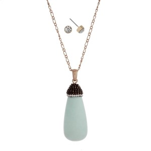 "Gold tone necklace set displaying a mint green natural stone pendant with pave rhinestones. Approximately 30"" in length."