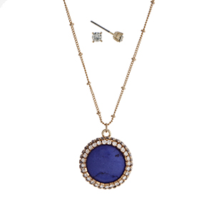 "Gold tone necklace set with a navy blue circle pendant accented with pave stones. Approximately 18"" in length."