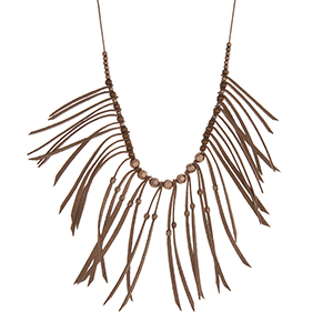 "Adjustable brown cord necklace with brown fringe and gold tone bead accents. Approximately 36"" in length."