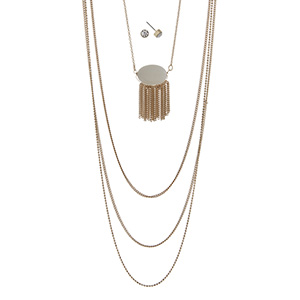 "Gold tone multi-layer necklace featuring an ivory stone with metal fringe. Approximately 32"" in length."