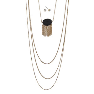 "Gold tone multi-layer necklace featuring a black stone with metal fringe. Approximately 32"" in length."