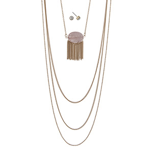 "Gold tone multi-layer necklace featuring a rose quartz stone with metal fringe. Approximately 32"" in length."