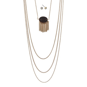 "Gold tone multi-layer necklace featuring a tiger's eye stone with metal fringe. Approximately 32"" in length."