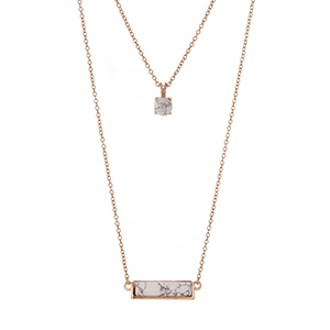 """Gold tone double layer necklace with howlite stones. Approximately 18"""" in length."""