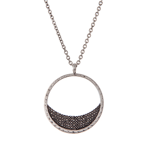 "Silver tone necklace with a circle pendant and gray pave stones. Approximately 32"" in length."